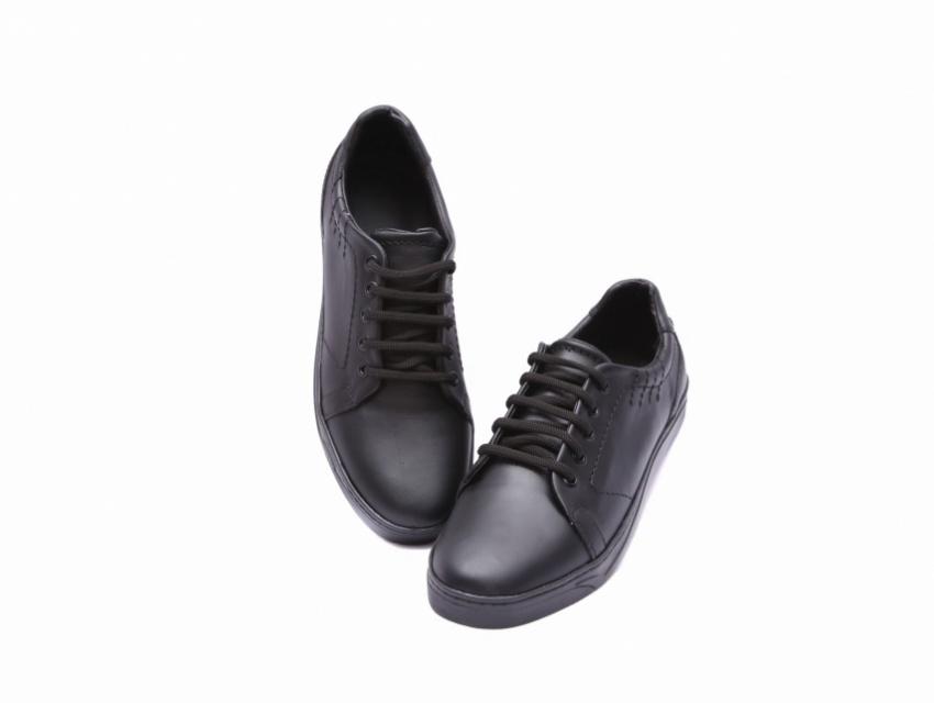 chaussure motif en cuir